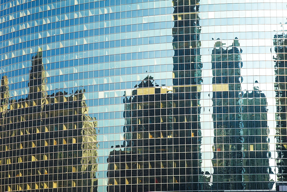 Reflection of skyscrapers in the glass facade of a building, Chicago, Illinois, United States of America