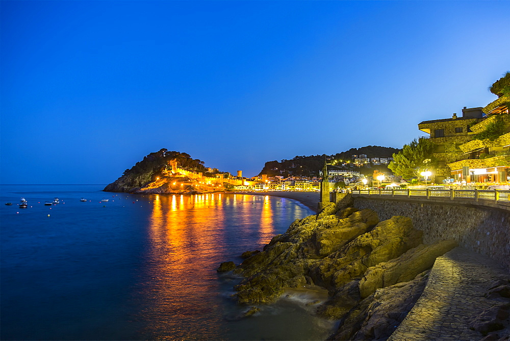 Night view from Tossa de Mar of Castell de Tossa, which was built in 1187, Tossa de Mar, Girona, Spain