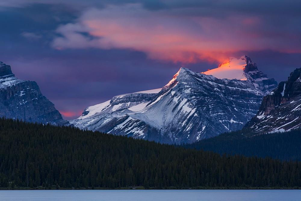 Sunrise illuminating the peaks of the Rocky Mountains over Bow Lake, Banff National Park, Improvement District No. 9, Alberta, Canada