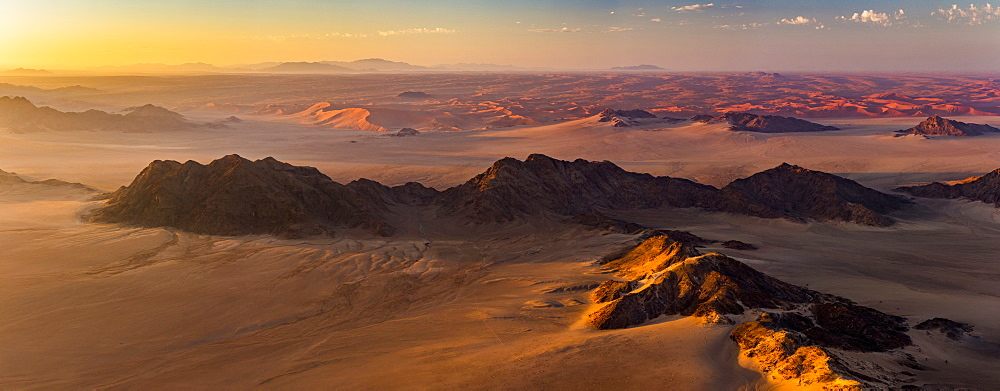 Aerial view of the sand dunes of the Namib Desert at sunrise, Sossusvlei, Hardap Region, Namibia