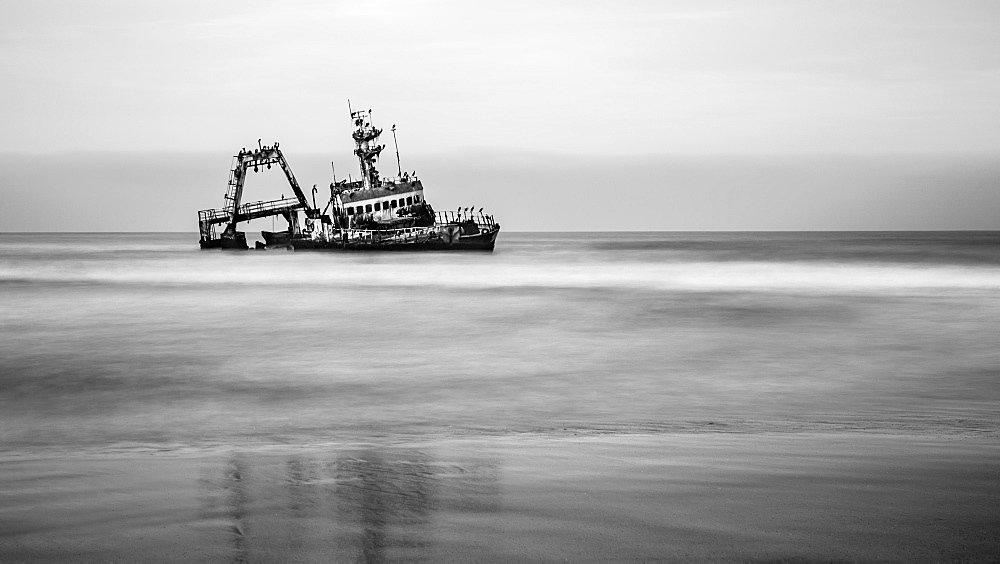 Black and white image of a shipwreck on Skeleton Coast, Sossusvlei, Hardap Region, Namibia