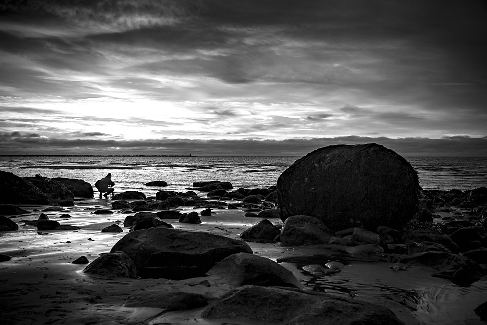 Black and white image of Wreck Beach at sunset, Vancouver, British Columbia, Canada