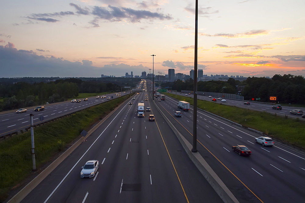 Highway 401 looking West towards Yonge Street at dusk, Toronto, Ontario, Canada