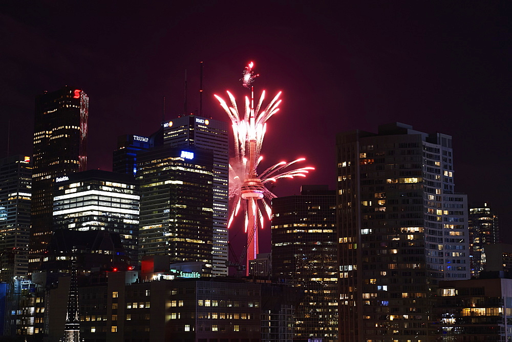 Red fireworks in the night sky in front of the CN tower, Toronto, Ontario, Canada - 1116-48804