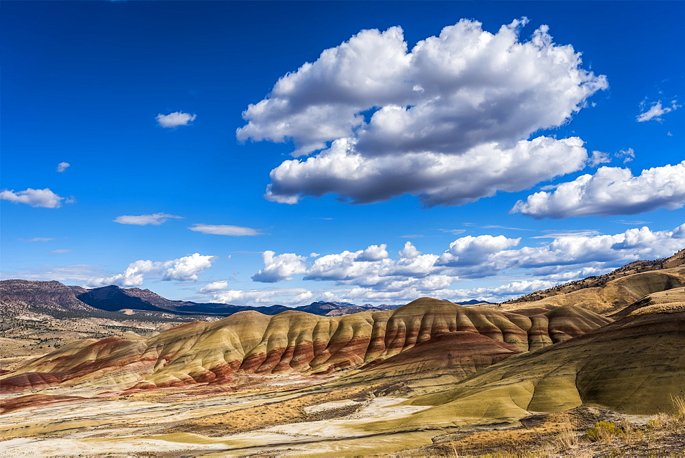 Clouds float above the Painted Hills Unit of John Day Fossil Beds National Monument, Mitchell, Oregon, United States of America