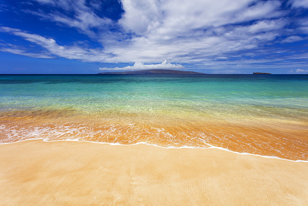 Turquoise ocean water and golden sand on Big Beach, Makena State Park, Makena, Maui, United States of America