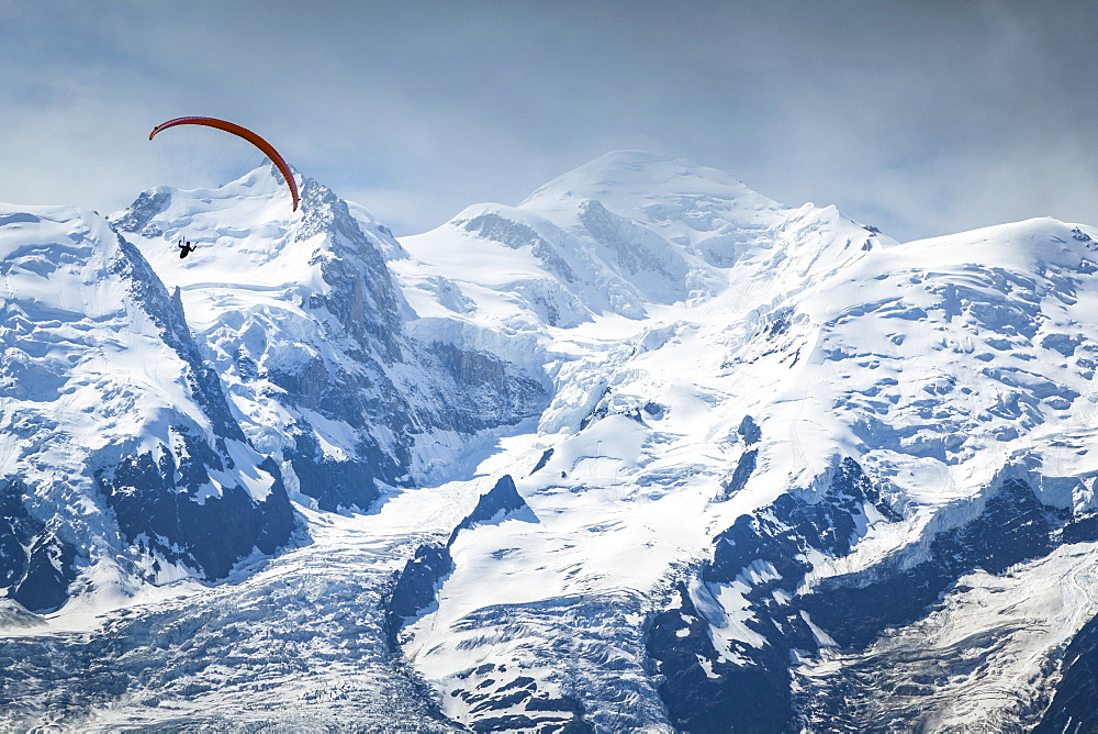 A paraglider flying over Mount Blanc in summer, Alps, Chamonix-Mont-Blanc, Haute-Savoie, France