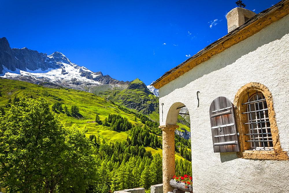 A small chapel at Ferret under blue sky, Ferret, Val Ferret, Switzerland