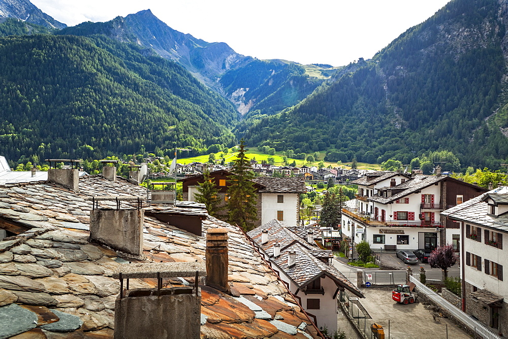 Historic stone roofs of buildings, viewed from city center of Courmayeur, Courmayeur, Aosta Valley, Italy