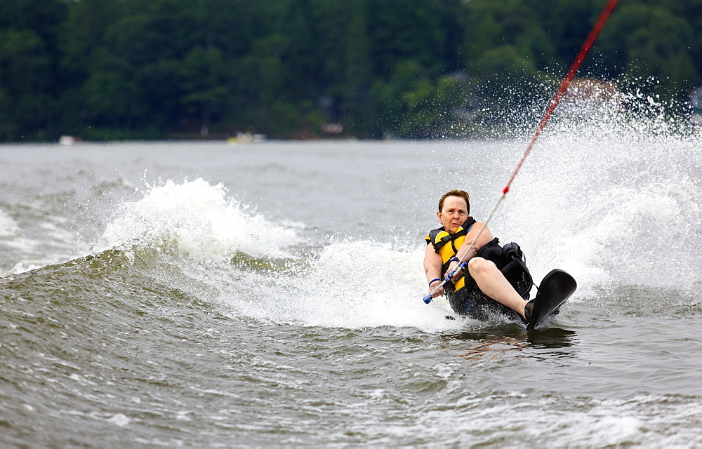Woman with one leg waterskiing