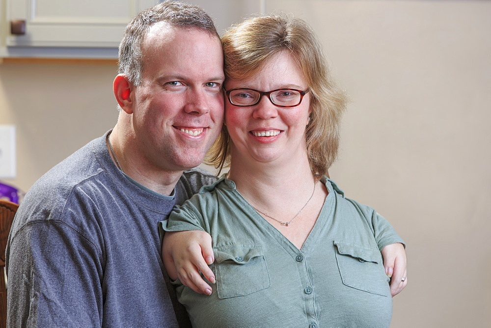 Portrait of a woman with TAR Syndrome and her husband
