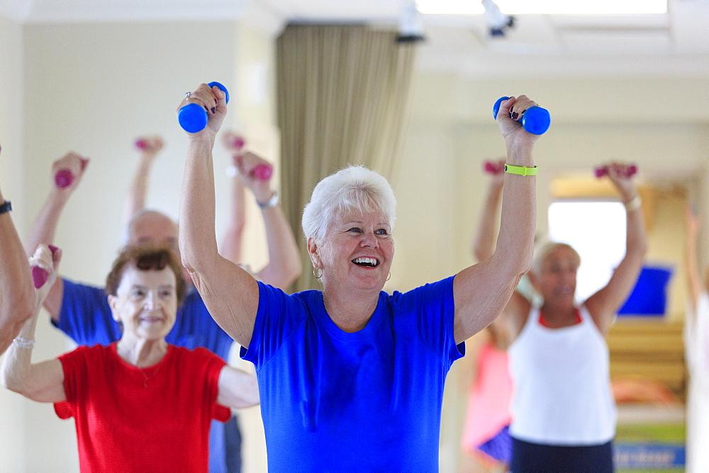 Senior people exercising in gym
