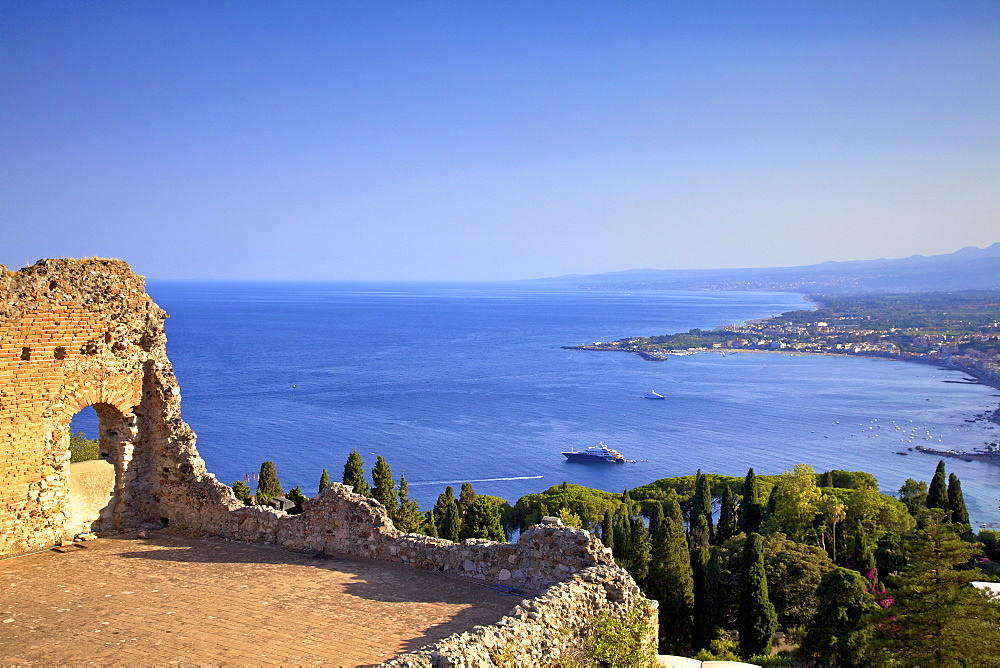 View from Greek Theatre with Mount Etna and coast in background, Taormina, Sicily, Italy, Mediterranean, Europe