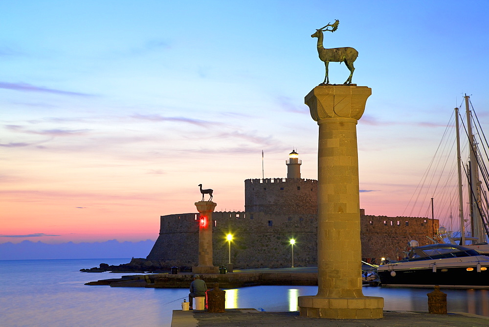 Bronze Doe and Stag statues at the entrance to Mandraki Harbour, Rhodes, Dodecanese, Greek Islands, Greece, Europe