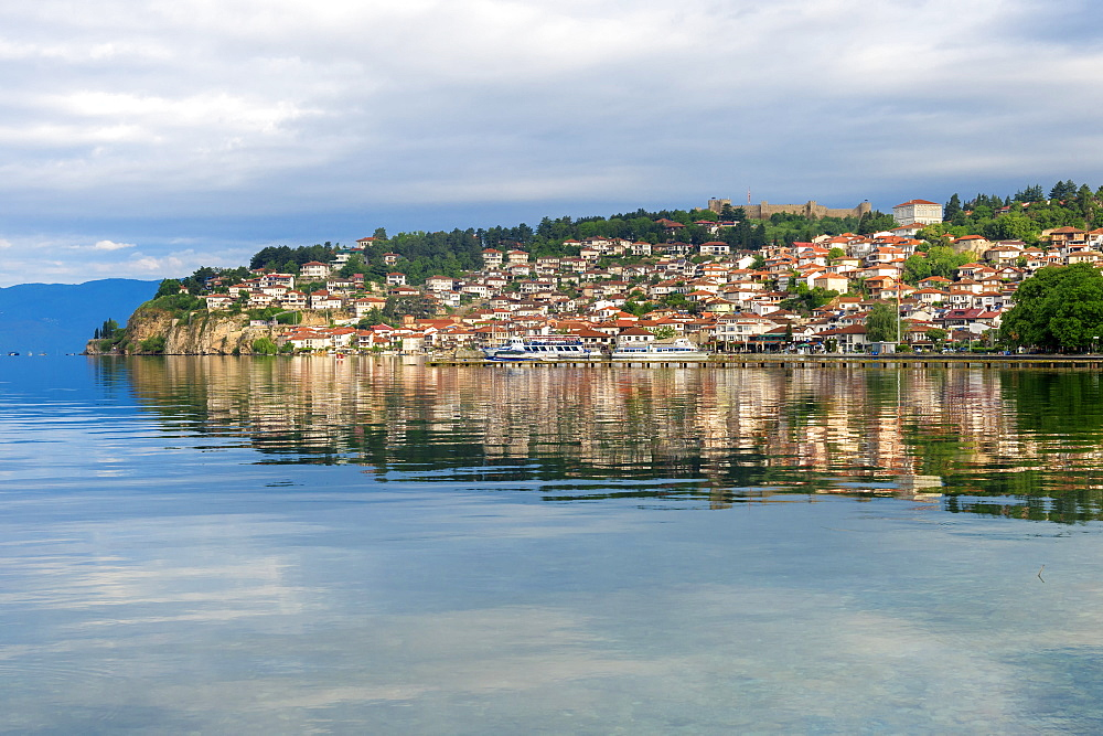 Ohrid old city reflected in Lake Ohrid, UNESCO World Heritage Site, Macedonia, Europe
