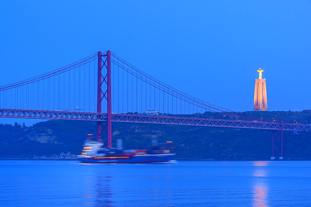 Cruise Ship passing under the Bridge of 25 April and Almada Cristo Rei statue at sunset, Belem district, Lisbon, Portugal - 1131-1202