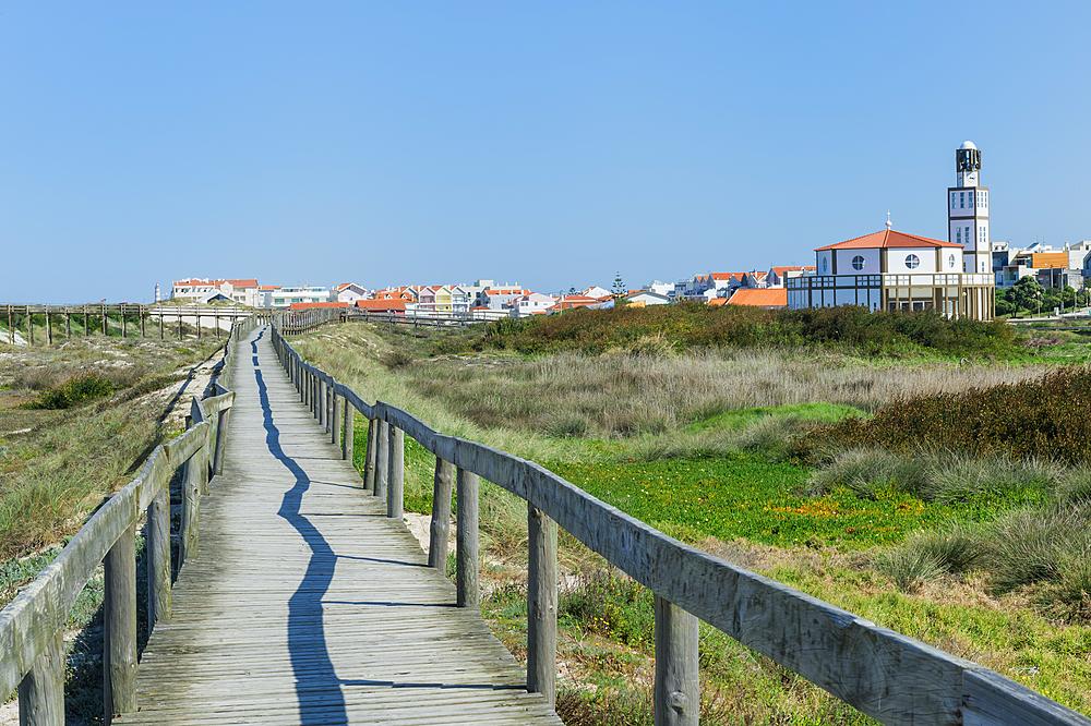Wooden footpath at Costa Nova Beach, Costa Nova Church behind, Aveiro, Venice of Portugal, Beira Littoral, Portugal, Europe
