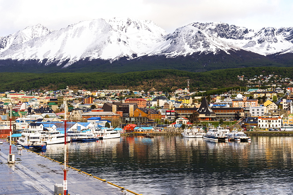 Ushuaia skyline and harbor, the southernmost city of Argentina dominated by snow covered mountains, Tierra del Fuego, Argentina, South America