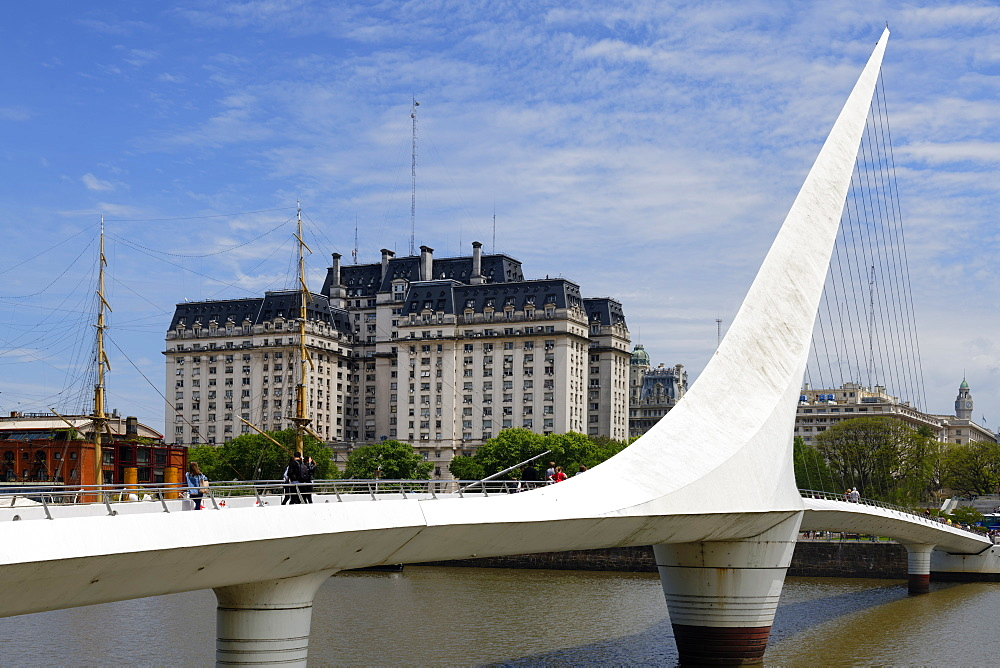 Women's rotating bridge, Puente de la Mujer, Ministry of Defence (Libertador) Building behind, Buenos Aires, Argentina, South America