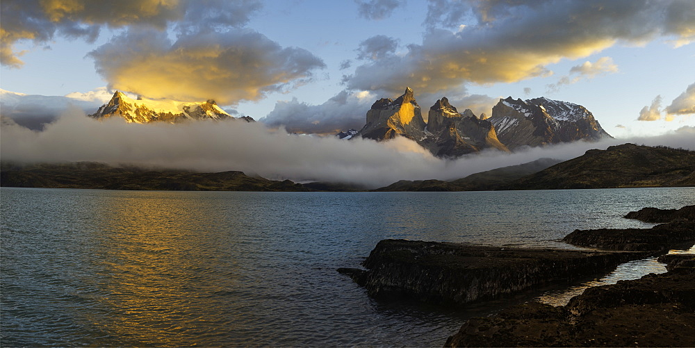 Sunrise over Cuernos del Paine, Torres del Paine National Park and Lago Pehoe, Chilean Patagonia, Chile, South America