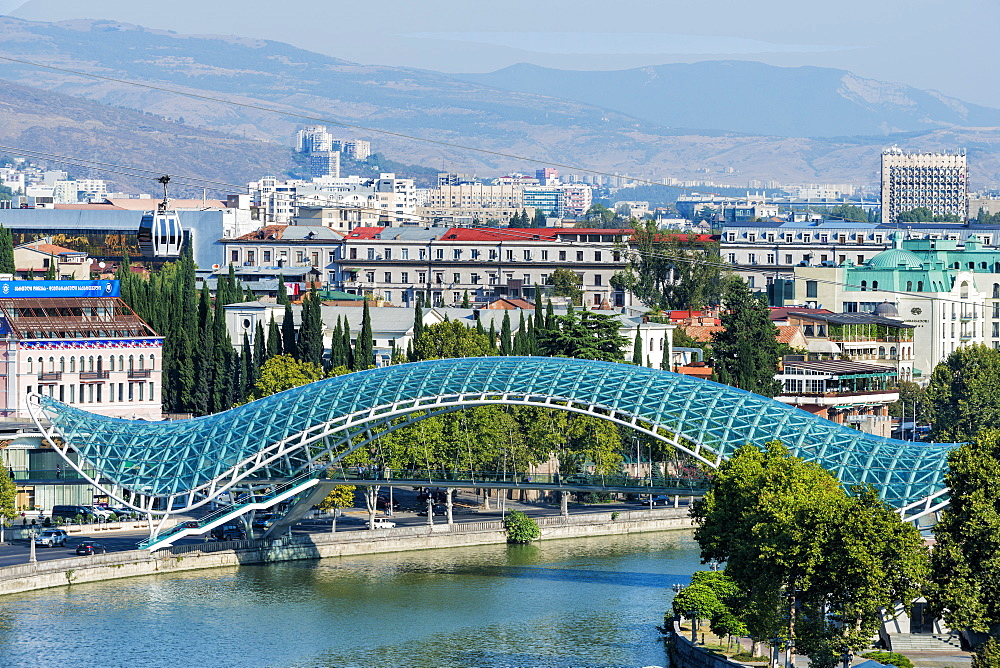 Peace Bridge over the Mtkvari river, Designed by Italian architect Michele de Lucci, Tbilisi, Georgia, Caucasus, Middle East, As