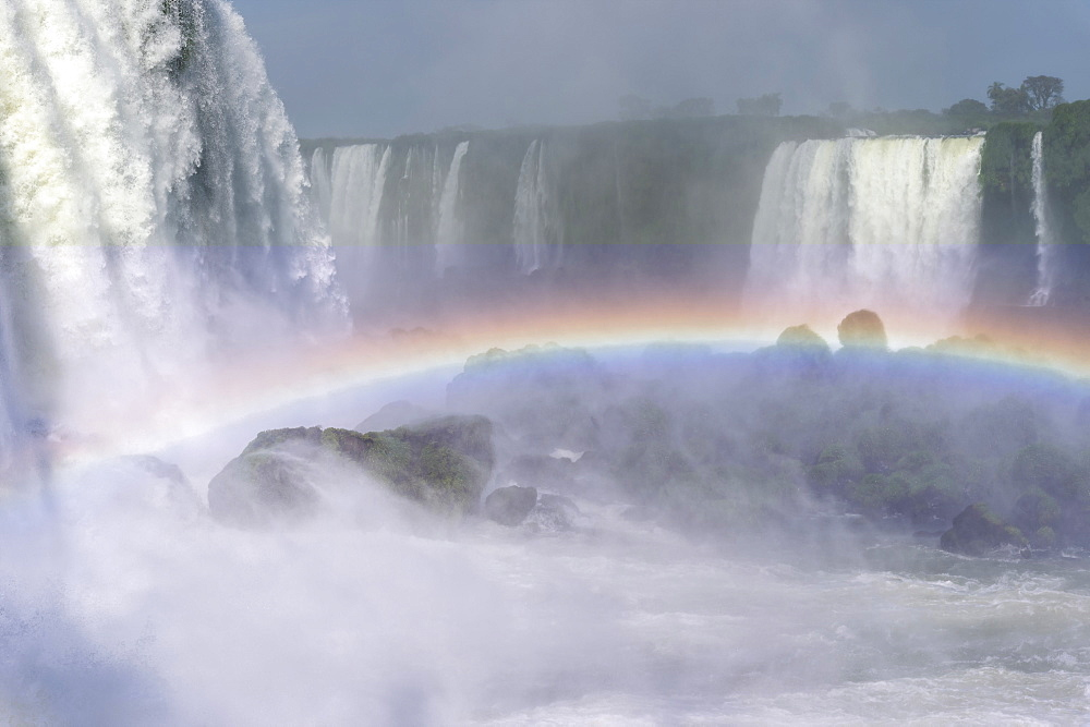 Rainbow over the Iguazu Falls, viewed from the Brazilian side, UNESCO World Heritage Site, Foz do Iguacu, Parana State, Brazil, South America