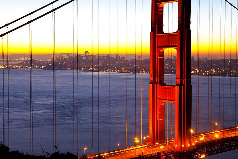Golden Gate Bridge and San Francisco skyline at dawn, San Francisco, California, United States of America, North America