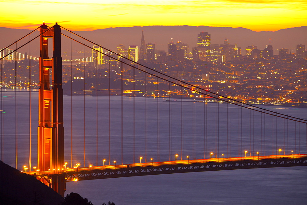 The Golden Gate Bridge and San Francisco skyline at sunrise, San Francisco, California, United States of America, North America