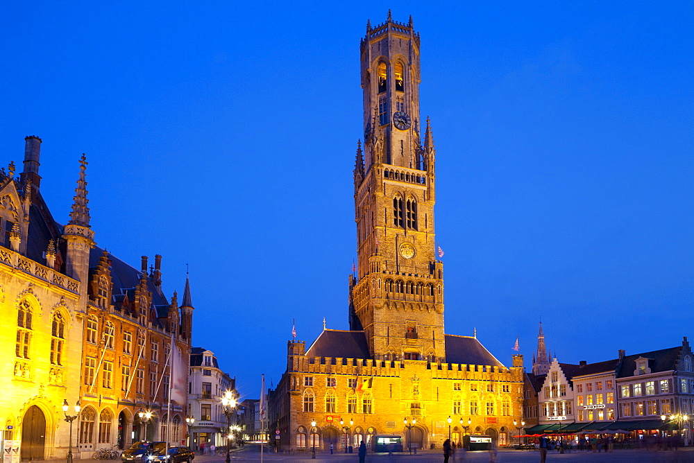 The Belfry and Market Square lit up at night in the Historic Center of Bruges, UNESCO World Heritage Site, Belgium, Europe