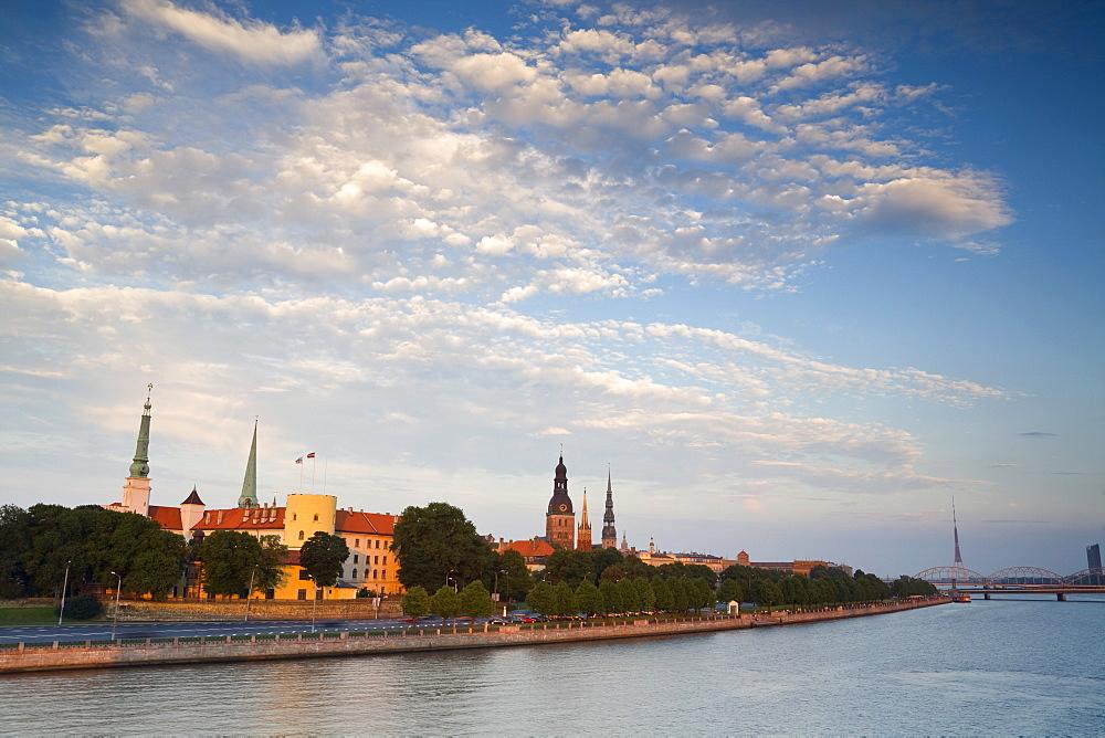 Riga Castle and the River Daugava illuminated at sunset, Riga, Latvia, Europe