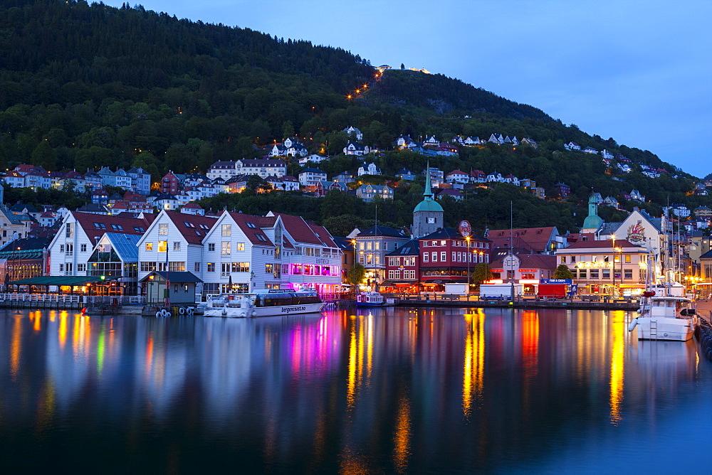 Bergen's picturesque Bryggen District illuminated at dusk, UNESCO World Heritage Site, Bergen, Hordaland, Norway, Scandinavia, Europe