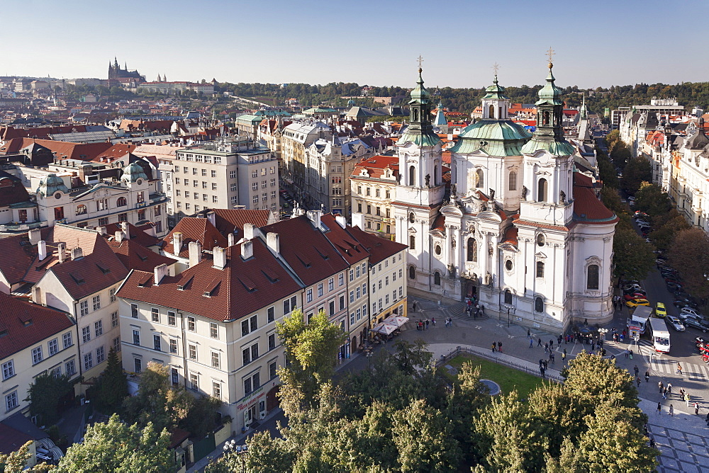 View over the Old Town Square (Staromestske namesti) to St. Nicholas Church and Castle District with Royal Palace and St. Vitus Cathedral, Prague, Bohemia, Czech Republic, Europe