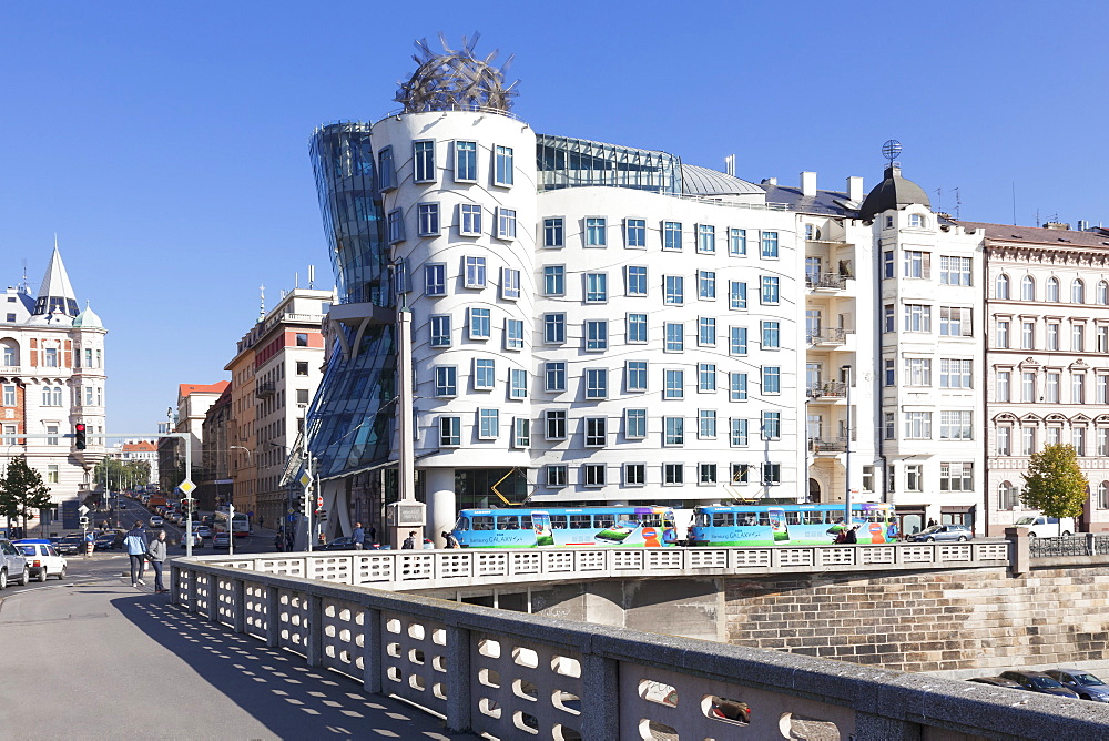 Tram in front of the Dancing House (Ginger and Fred) by Frank Gehry, Prague, Bohemia, Czech Republic, Europe