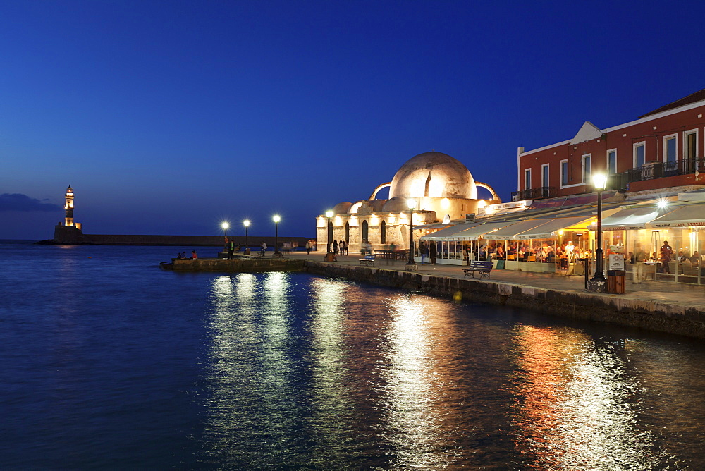 Lighthouse at Venetian port and Turkish Mosque Hassan Pascha at night, Chania, Crete, Greek Islands, Greece, Europe