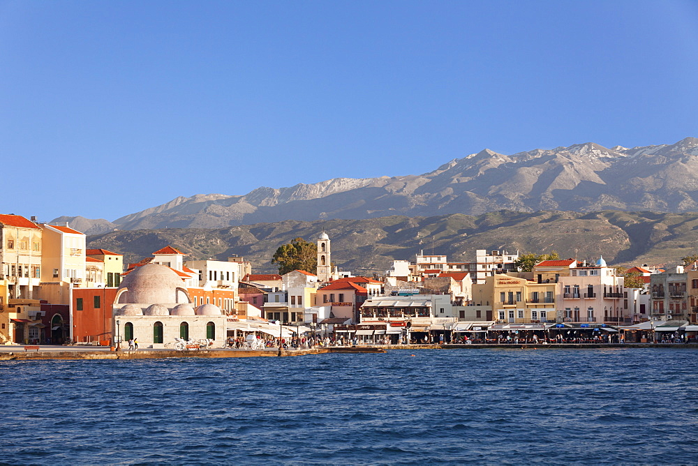 Venetian port and Turkish Mosque Hassan Pascha in front of Lefka Ori Mountains (White Mountains), Chania, Crete, Greek Islands, Greece, Europe