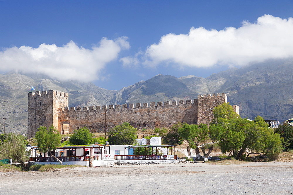 Venetian Castle in front of Lefka Ori Mountains (White Mountains), Frangokastello, Chania, Crete, Greek Islands, Greece, Europe
