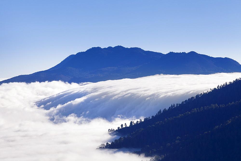 View from Caldera de Taburiente at cloud waterfall of Cumbre Nueva, Parque Nacional de la Caldera de Taburiente, La Palma, Canary Islands, Spain, Europe
