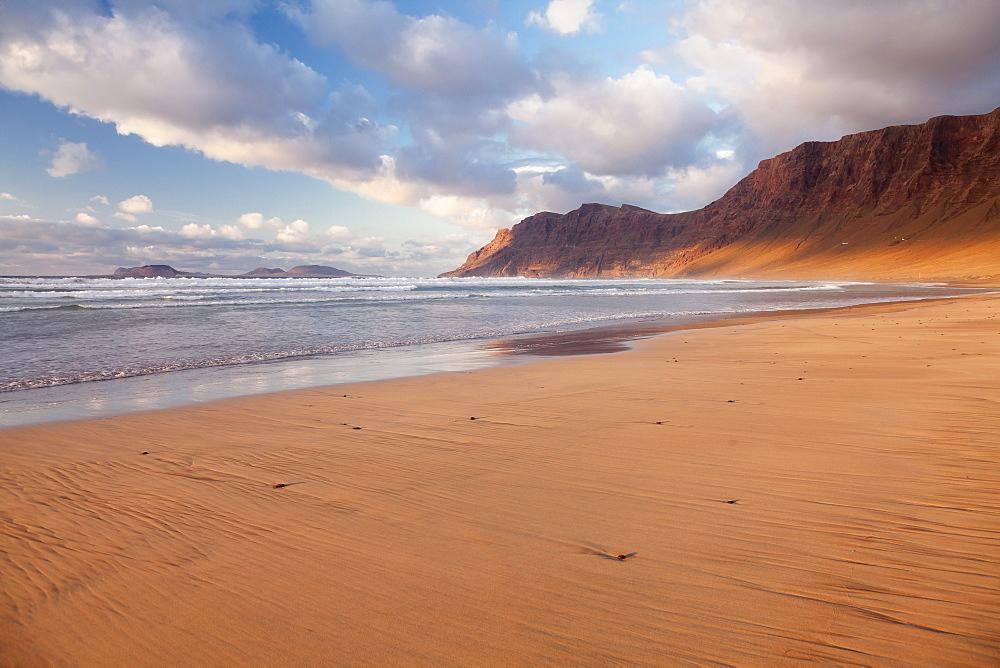 Famara Beach and Famara Mountains at sunset, view to La Graciosa Island, Lanzarote, Canary Islands, Spain, Atlantic, Europe