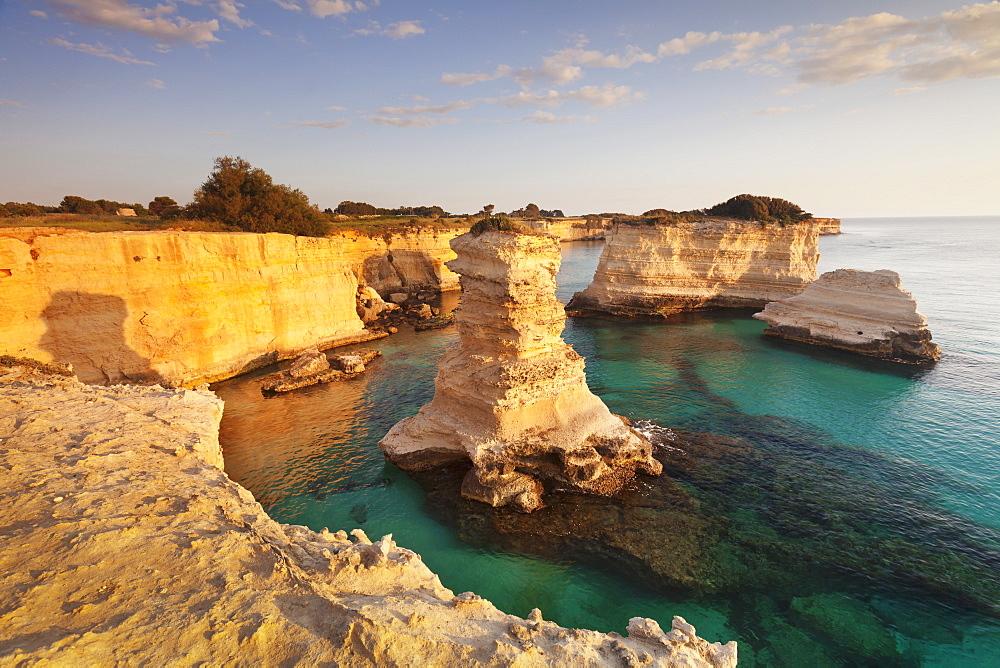 Rocky columns, natural monument, rocky coast at sunrise, Sant'Andrea, Adriatic Sea, Lecce province, Salentine Peninsula, Puglia, Italy, Europe
