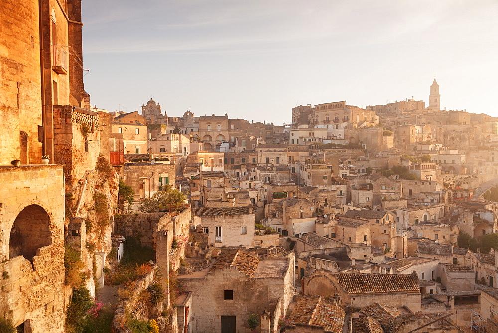 View over Sasso Caveoso to the cathedral at sunrise, UNESCO World Heritage Site, Matera, Basilicata, Puglia, Italy, Europe