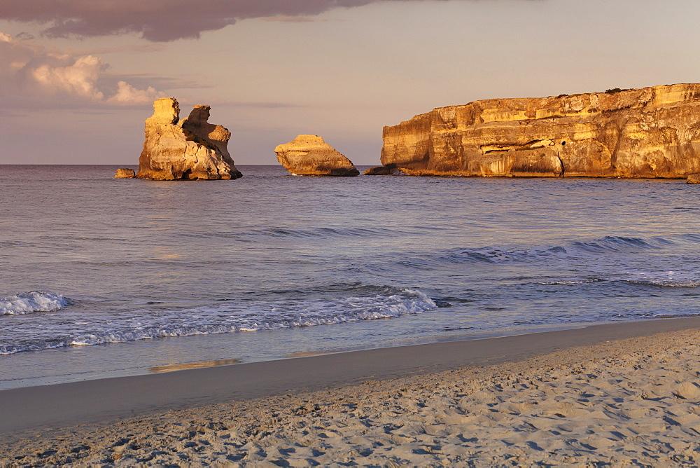 Rocky coast near Torre dell'Orso, Due Sorello Rocks (Two sisters) at sunset, Adriatic Sea, Lecce province, Salentine Peninsula, Puglia, Italy, Mediterranean, Europe