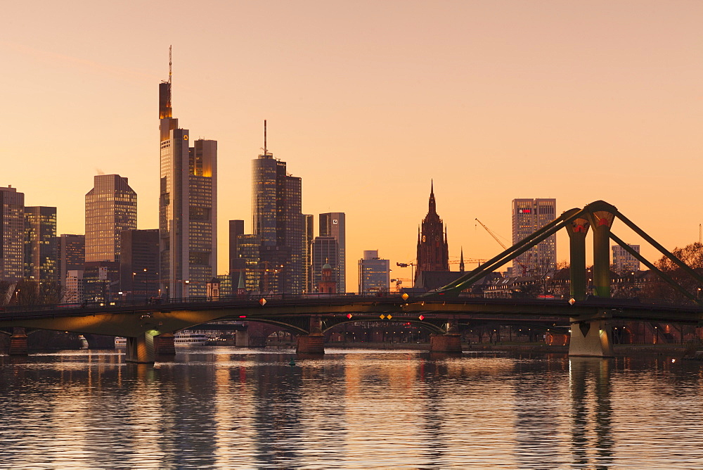 View over Main River to Floesserbruecke bridge and financial district, Frankfurt, Hesse, Germany, Europe