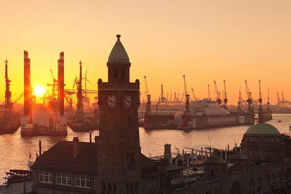 St.Pauli Landungsbruecken pier against harbour at sunset, Hamburg, Hanseatic City, Germany