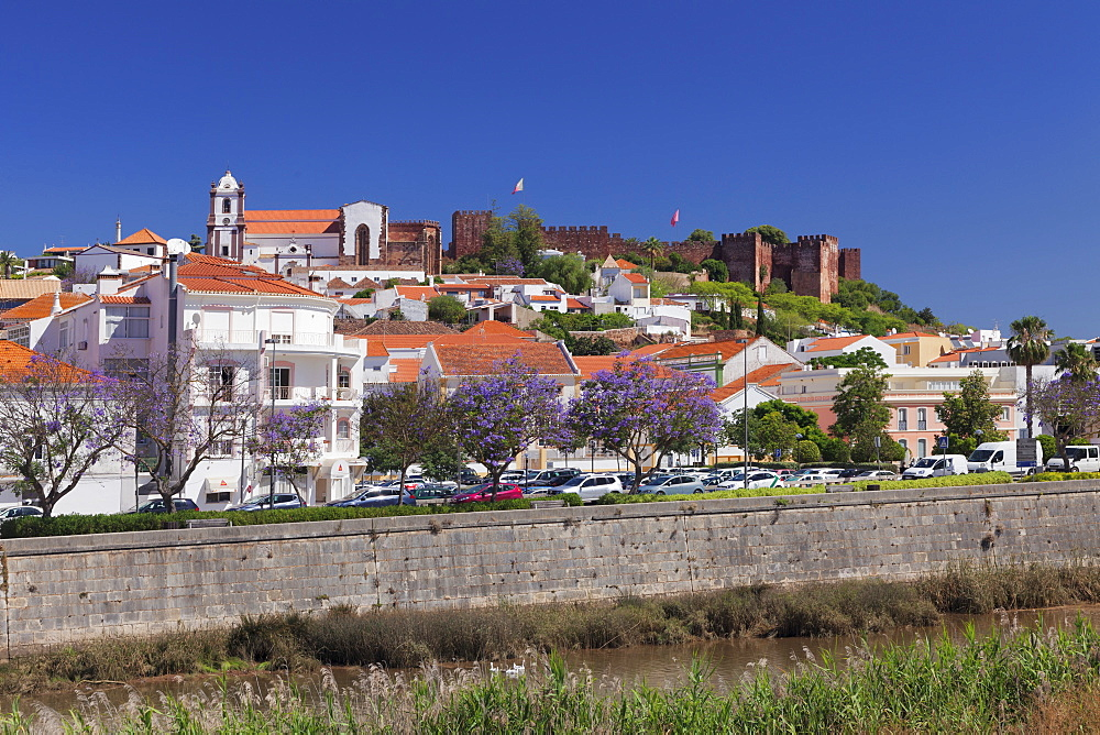 View over Rio Arade river to the cathedral and castle, Silves, Algarve, Portugal