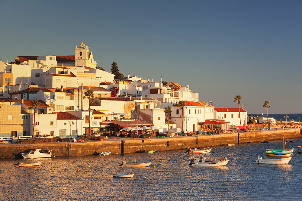 Ferragudo fishing village at sunset, near Portimao, Algarve, Portugal