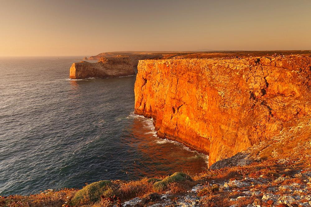 Cliff coast at sunset, Cabo de Sao Vicente, Sagres, Algarve, Portugal, Europe