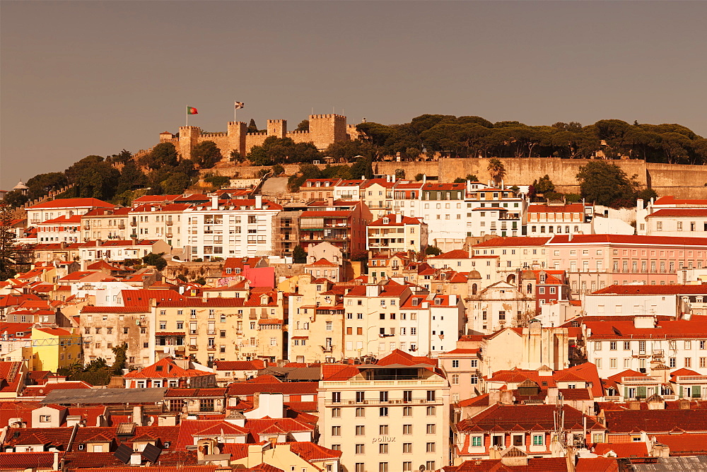 View over the old town to Castelo de Sao Jorge castle at sunset, Lisbon, Portugal