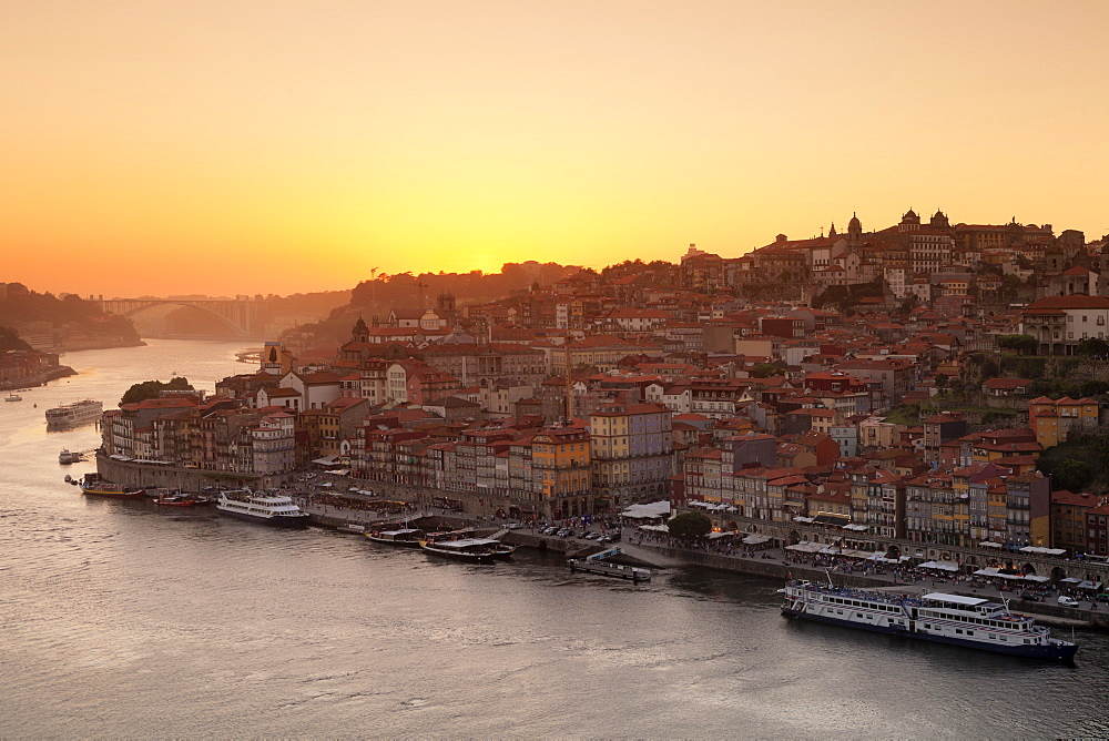 View over Douro River at sunset to Ribeira District, UNESCO Wolrd Heritage Site, Porto, Oporto, Portugal