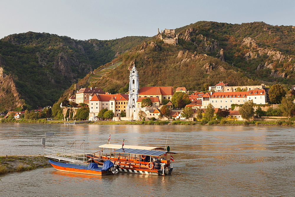 View over Danube River to Collegiate church and castle ruins, Durnstein, Wachau, Lower Austria, Austria, Europe