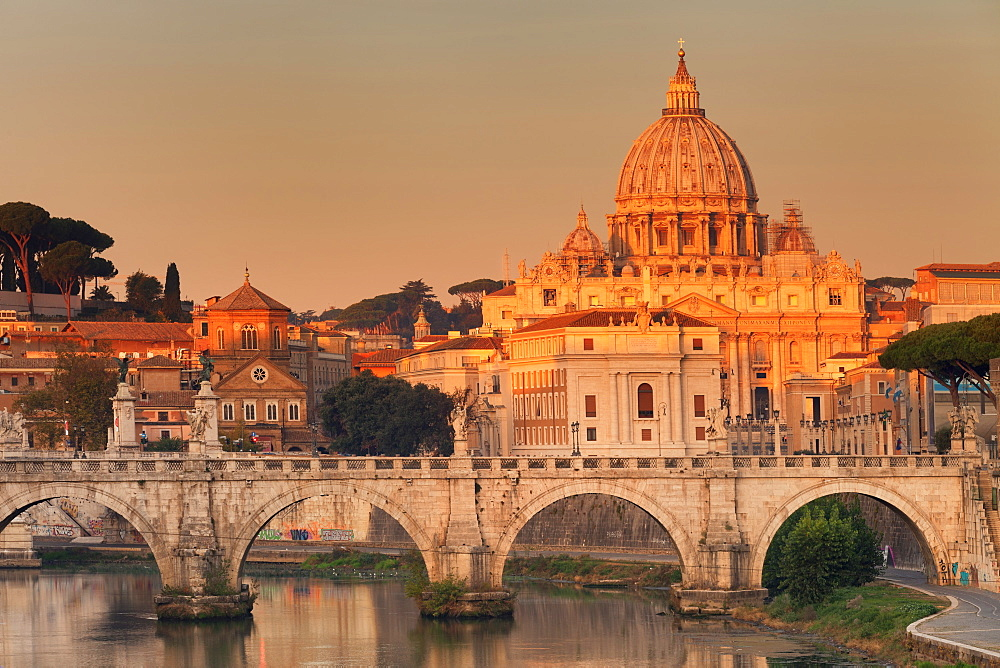 View over Tiber River to Ponte Vittorio Emanuele II Bridge and St. Peter's Basilica at sunrise, Rome, Lazio, Italy, Europe - 1160-3833
